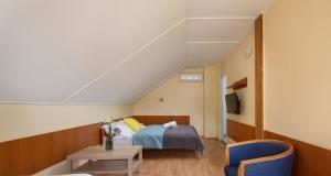 Emeleti háromágyas szoba