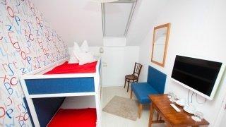 Három ágyas gyerekszoba a kétlégterű családi szobában